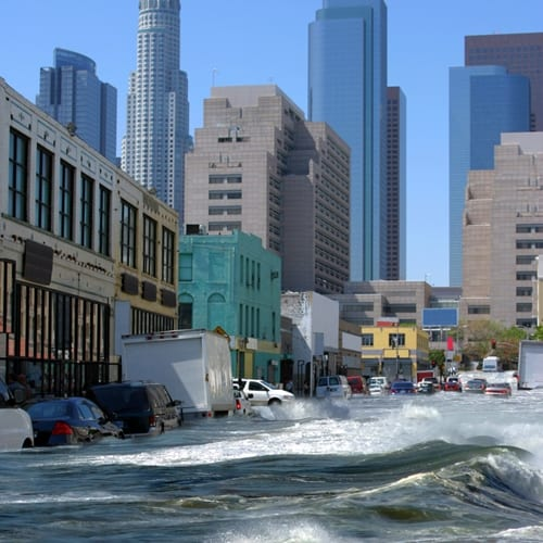 Flood risk, exacerbated by climate change, has cities scrambling to raises bridges.